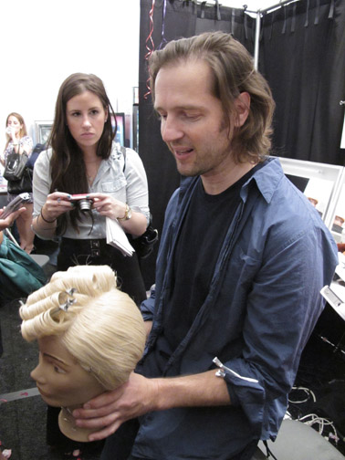 Peter Gray demonstrates the look for the show on a mannequin.