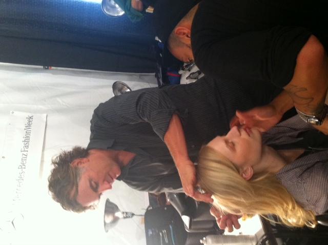 Rorney Cutler braids a model's hair