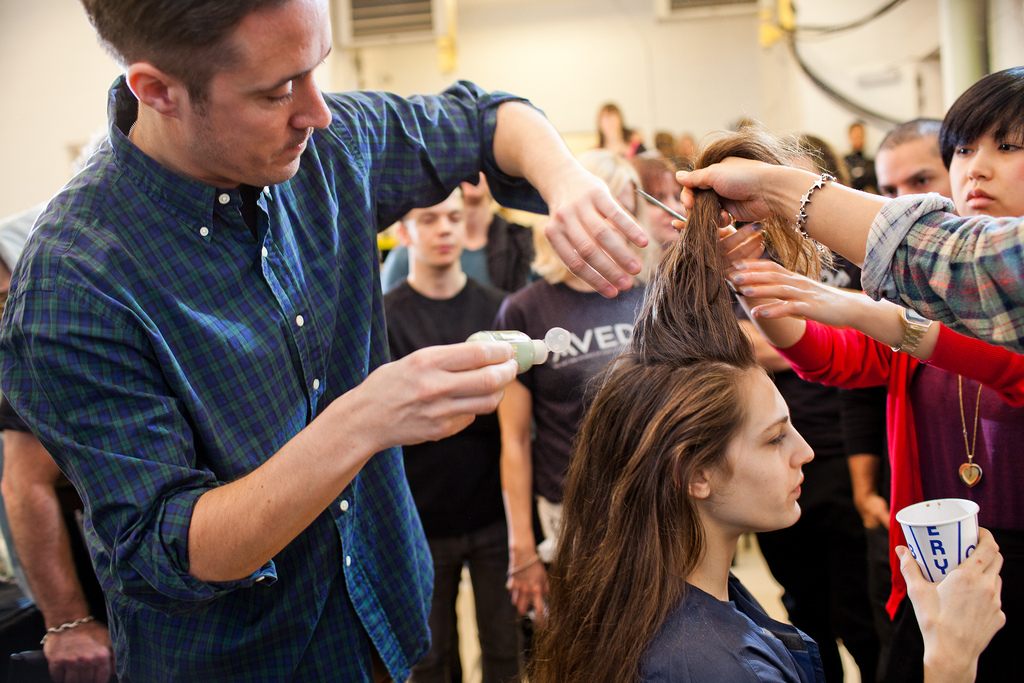Paul Hanlon adding Aveda Pure Abundance Hair Potion to the roots