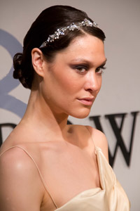 After twisting, Hawkins coiled the hair into a low chignon at the base of the next, which made a classic hairstyle a little more interesting.