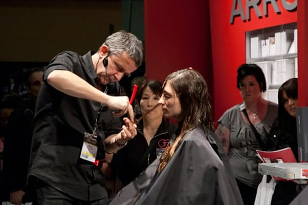More than 650 exhibiting companies were on-hand showcasing new products and showing the hottest looks and trends in hair and makeup.  Here Nick Arrojo concentrates at his booth while showing his fans important techniques.