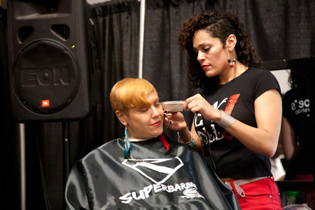 The popular two-day Super Barber Cutting Competition, presented by Major League Barber and hosted by Andis and Mr. Beauty, awarded cash prizes and Major League Barber products to winners in two categories: Color & Design Cuts and Conservative & Traditional Cuts.  Here a competitor from Denny Mo's Superstar Barbershop of New York City.