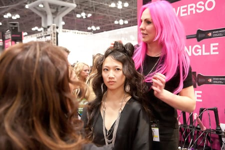 Beauty takes over at the Enzo Milano booth where pink seemed to be the go-to color and styles featured hair bows!