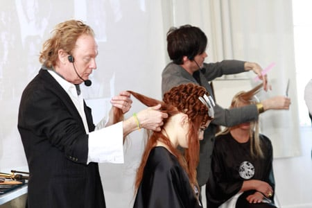 Oribe Hair Care Creative Director Ronnie Stam styling a model