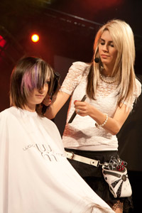 Amy Michleb putting the final touches on this model rocking cut and color.
