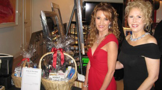 Jane Seymour and celebrity stylist Marie Ferro with donation product baskets from participating industry companies.