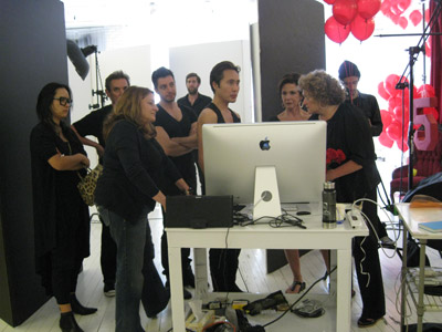 The entire team gathers around the computer to check out the latest images.