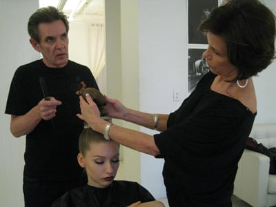 Husband and wife Brian and Sandra Smith work together to style model Elizaveta's next 'do.