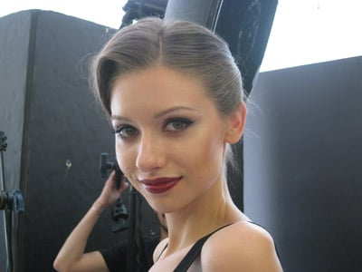Model Elizaveta shows off her next look before shooting with photographer David Byun.