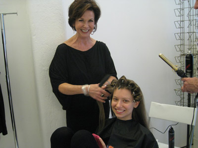 Sandra Smith, Matrix co-artistic director with her husband Brian Smith, styles model Elizaveta's hair for the first look.