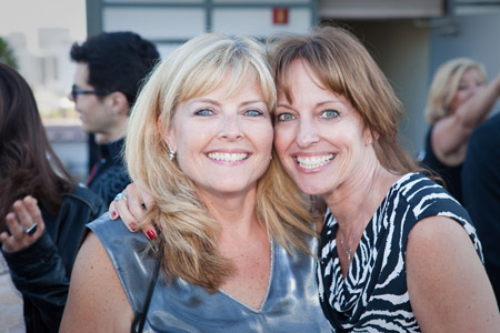 Sebastian Professional's Debbie Sturney and American Salon's Kristine Compton embrace for the camera.