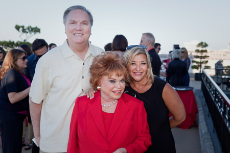 Kenquest's Bill Crowe and John Paul Mitchell Systems' Kristin Firrell with L.A. party host and Redken Founder Paula Kent Meehan.