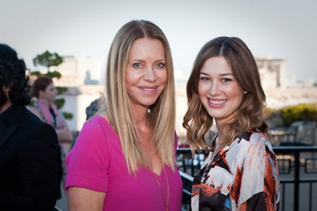 Neil George salon's Amanda George (left) smiles with Allie Paronelli.