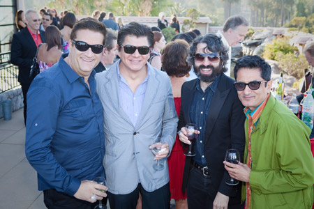 Brett Vinovich, Javier Ramos, Pedro Zalba and Albert Sanchez enjoy the company of one another at the party.