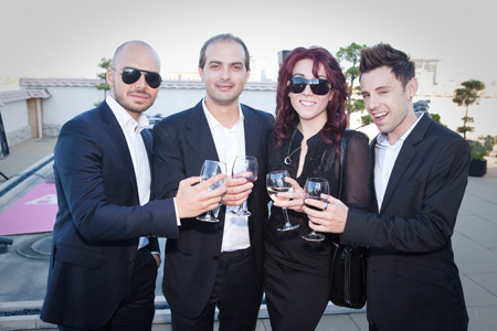 The gang from Vito Esposito Salon has a celebratory toast.