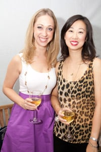 Oribe Hair Care's Lori Morris (left) and Lisa Tan put socializing on pause to stand still for the camera.