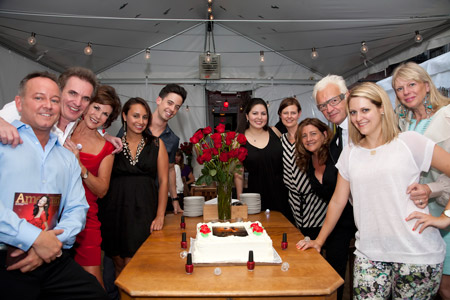 The Matrix and American Salon teams gather around the celebratory cake.