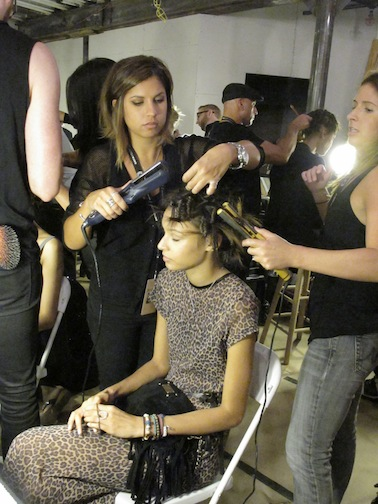 The hair team clamped the figure-eight sets with a flat-iron.