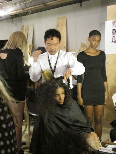Lead hairstylist for Oribe Kien Hoang backstage at Skaist Taylor