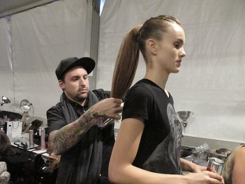 Lead stylist for L'Oréal Professionnel Joseph DiMaggio backstage at Timo Weiland