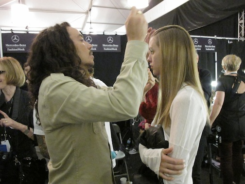 Lead stylist for Moroccanoil Orlando Pita backstage at Carolina Herrera