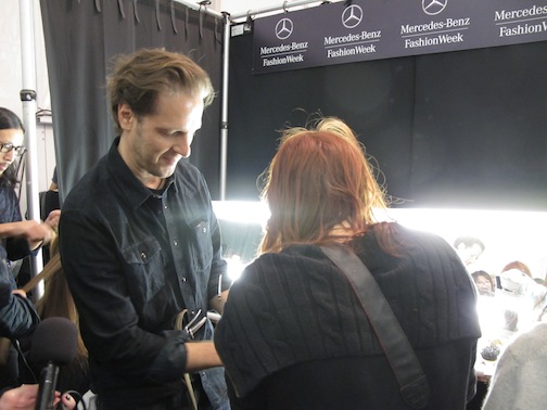 Lead stylist Peter Gray for Moroccanoil backstage at Badgley Mischka