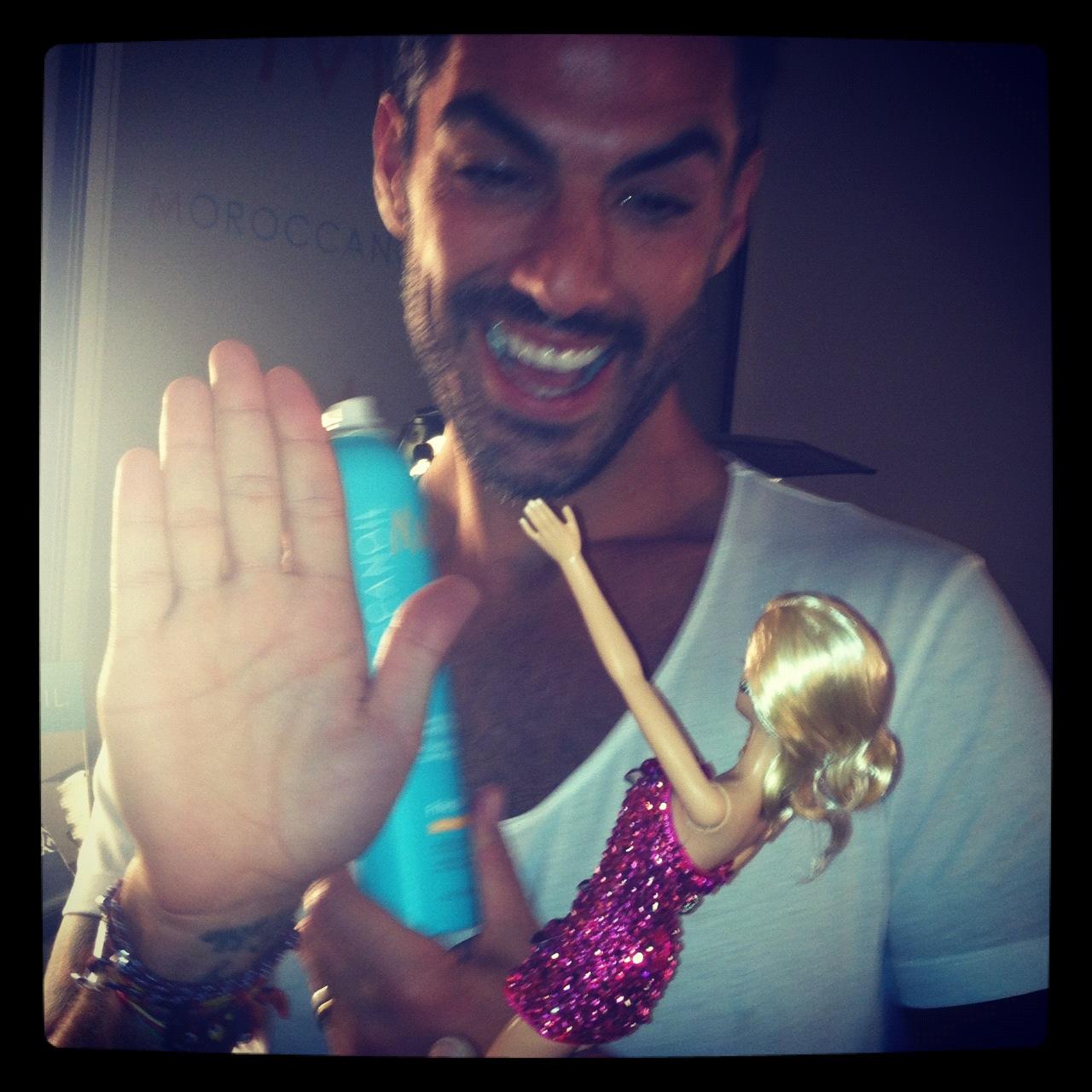 Antonio high-fiving Barbie