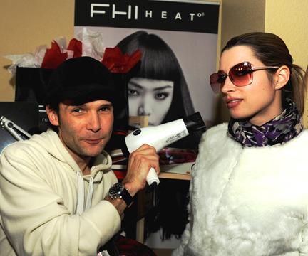 Actor Corey Feldman poses with FHI Heat blow-dryer.