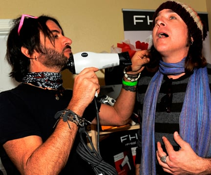 Rami Jaffee, keyboardist for the Foo Fighters, touches up Singer Jonny Kaplan's hair..
