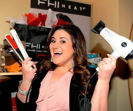 Actress KayCee Stroh shows off FHI Heat straightener and blow-dryer.