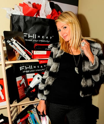 Paris Hilton strikes a pose with FHI Heat's hot tools.