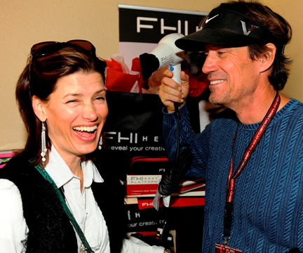 Kevin Sorbo gets a laugh out of wife Sam in the FHI Heat booth.