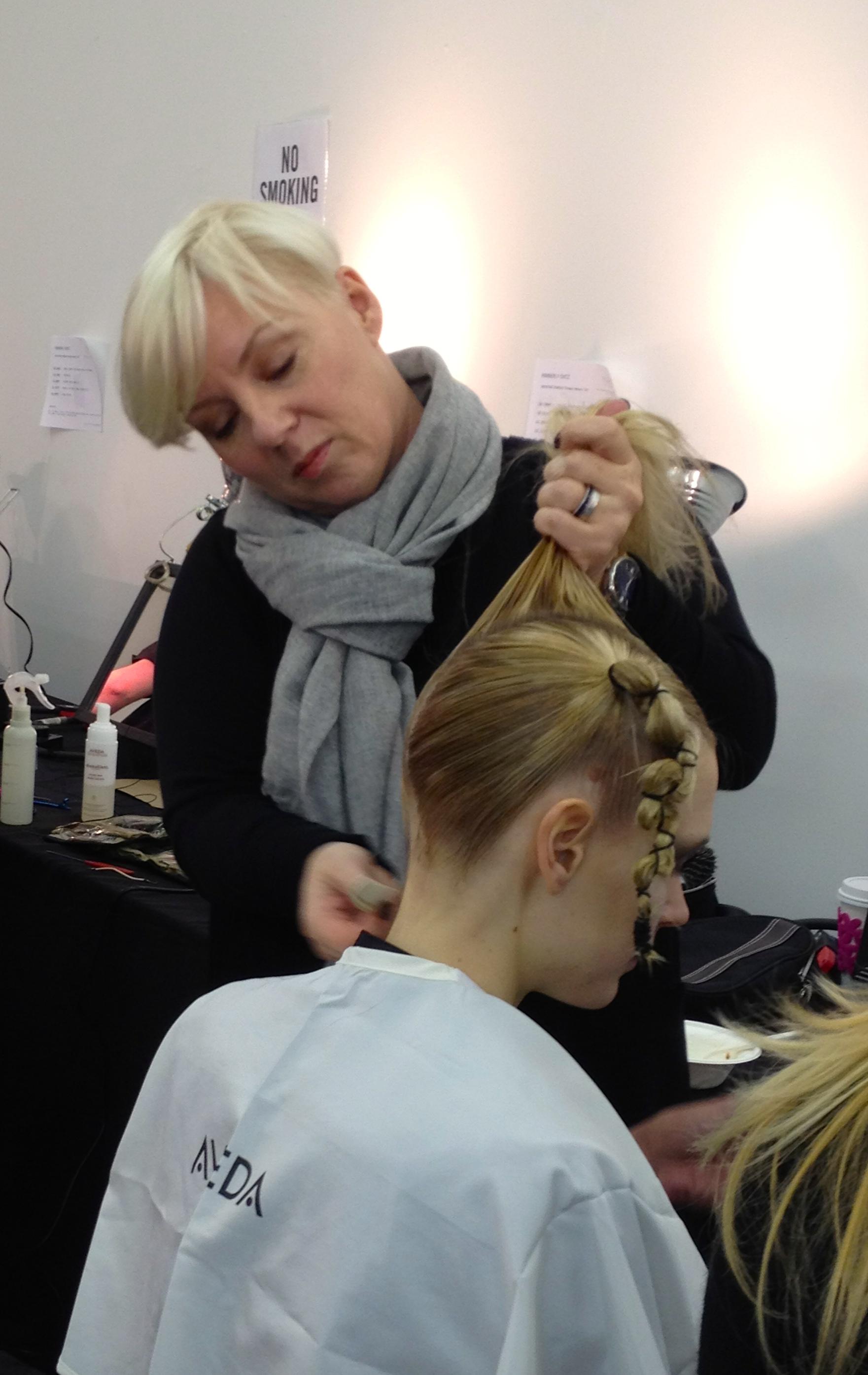 Antoinette Beenders creating shield of hair for Kimberly Ovitz show.