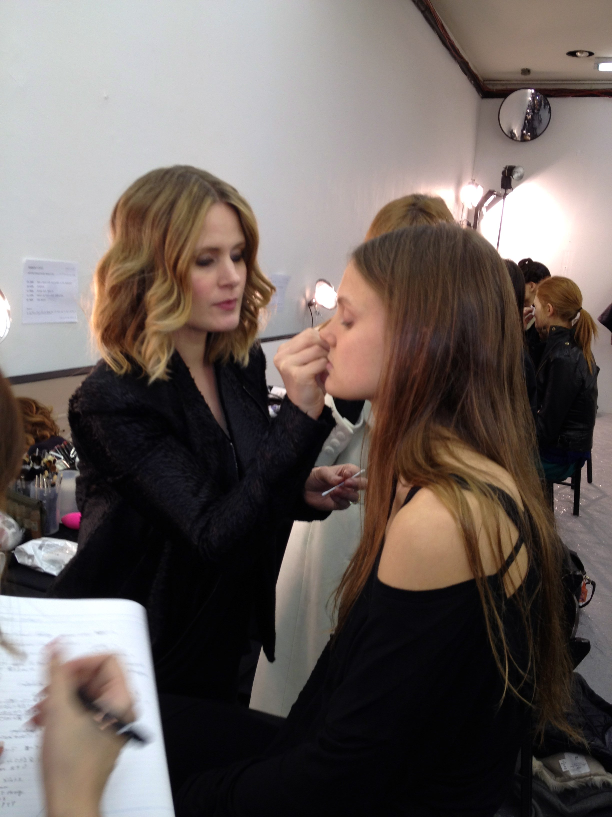 Gina B applies sculpting cream on model.
