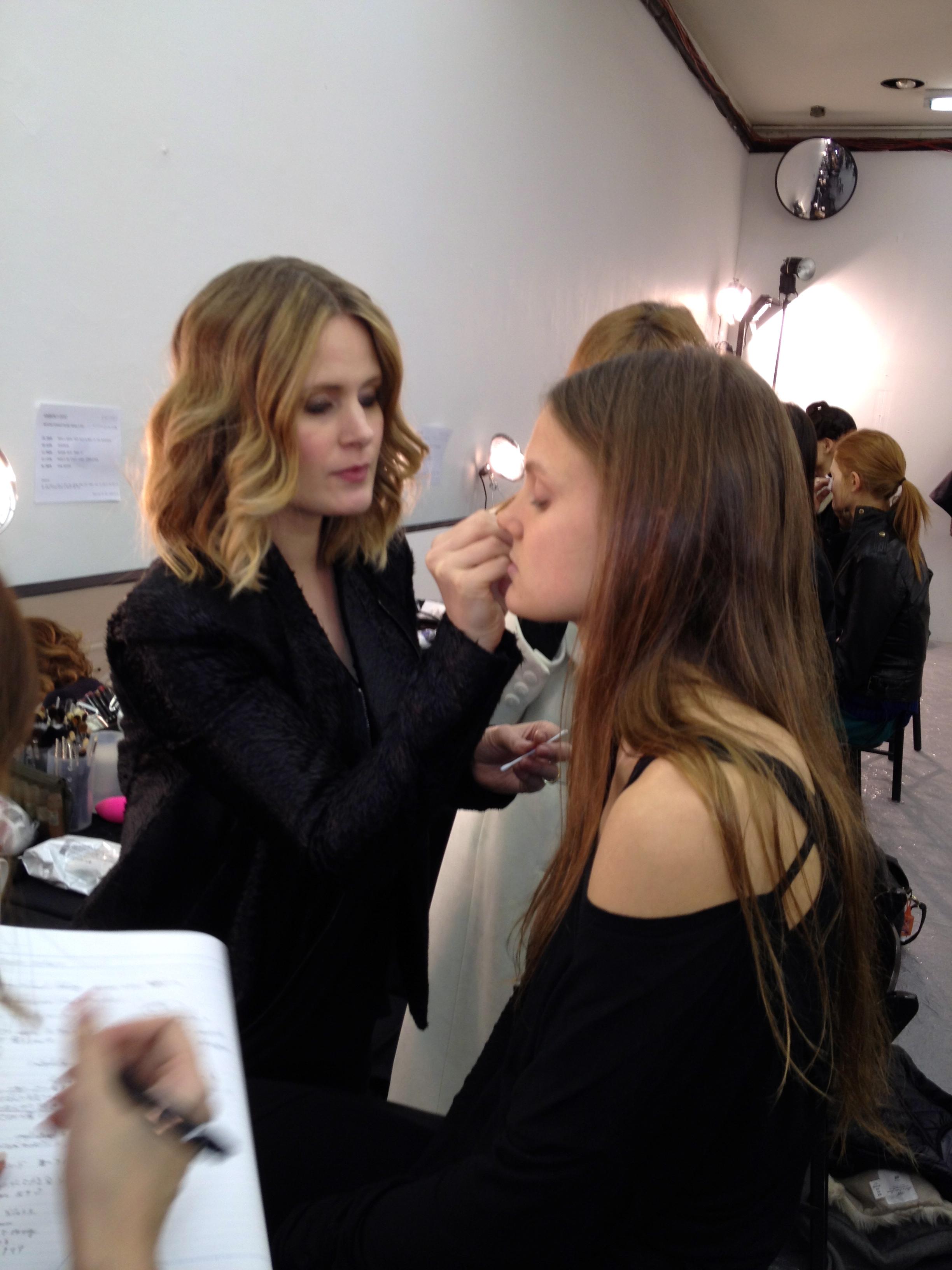 Gina B applies sculpting cream on model.