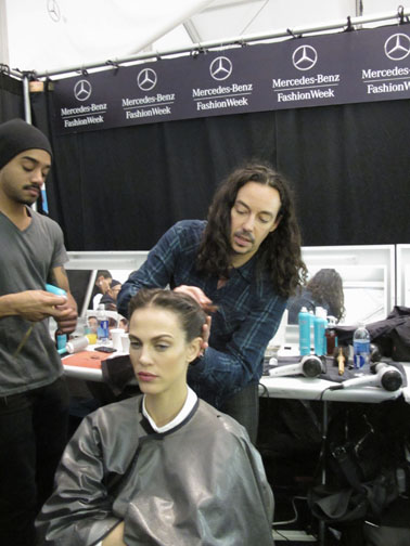 Lead hairstylist for Moroccanoil Orlando Pita backstage at Carolina Herrera