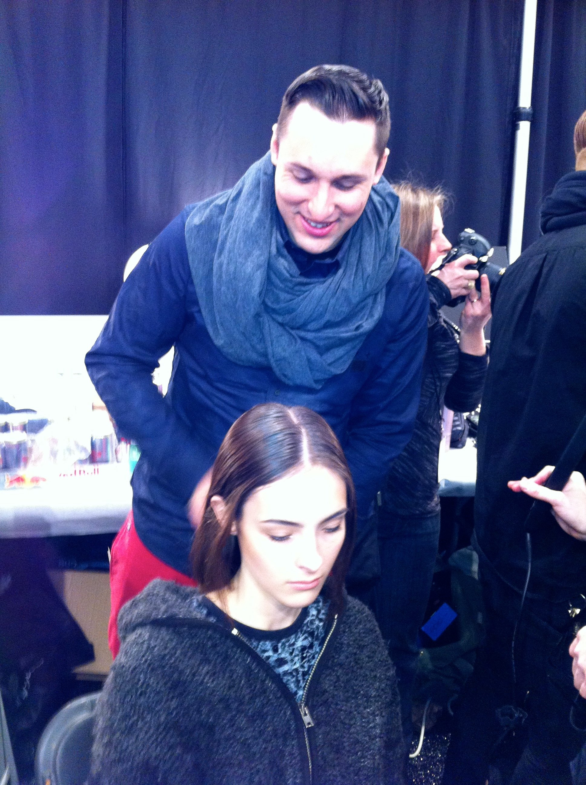 Lead hairstylist Joseph DiMaggio backstage at Timo Weiland
