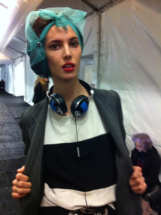 Hairnets protected the models' curls backstage while they set.