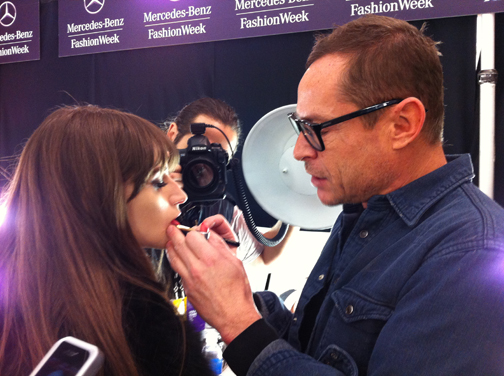 Lead makeup artist for M.A.C Tom Pecheux backstage at Badgley Mischka