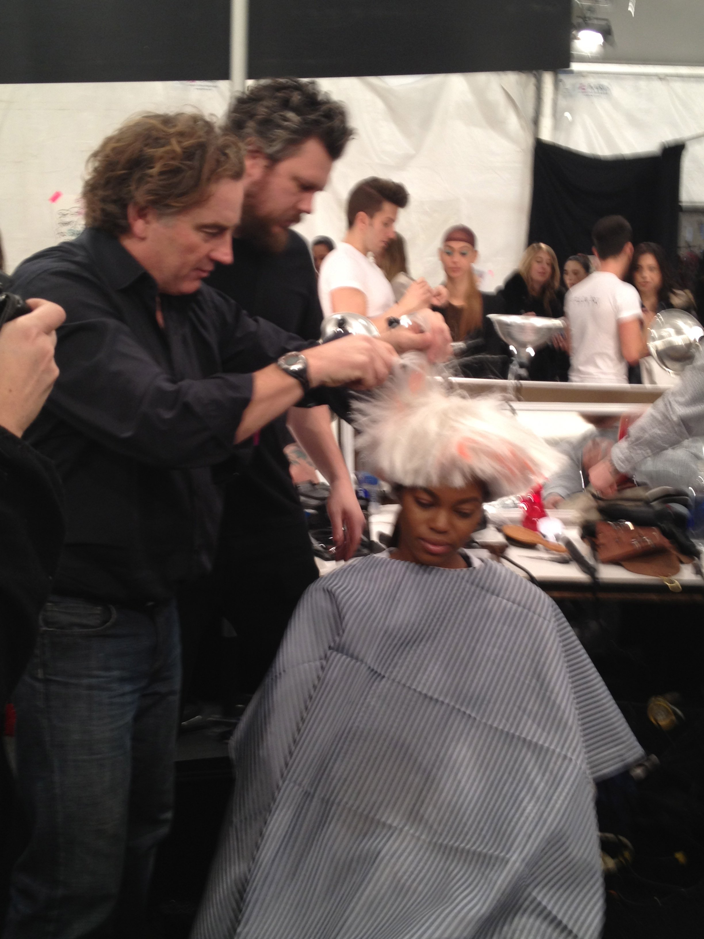 Rodney Cutler adds texture to wig.