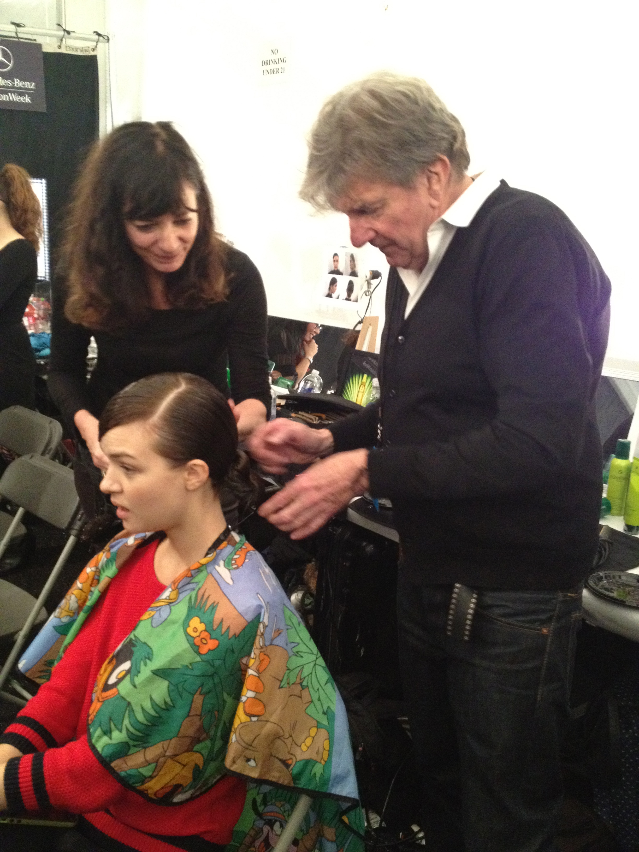 Didier Malige secures chignon backstage.
