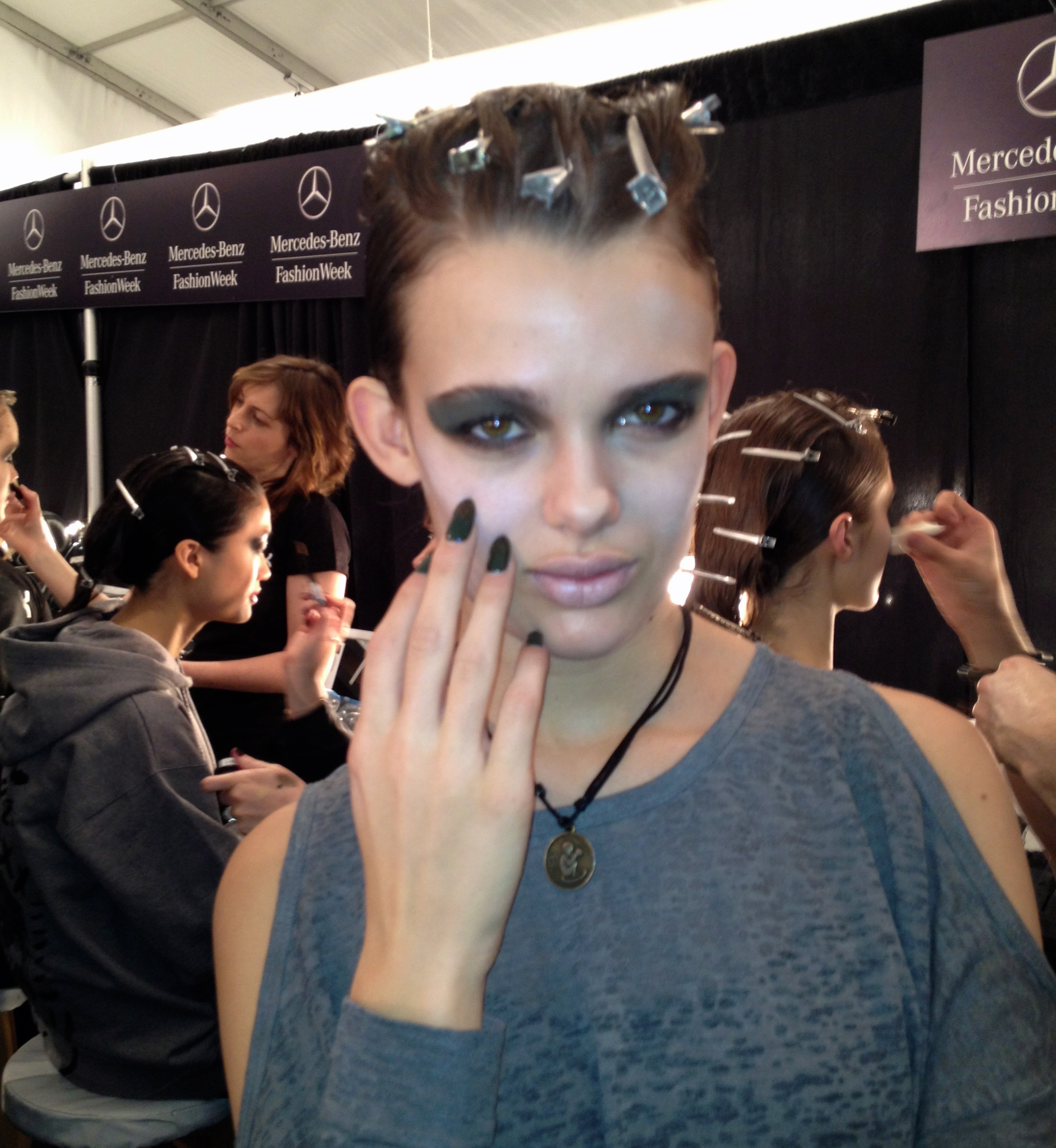 Nicholas K beauty look: glitter-tipped nails and dark eyes.