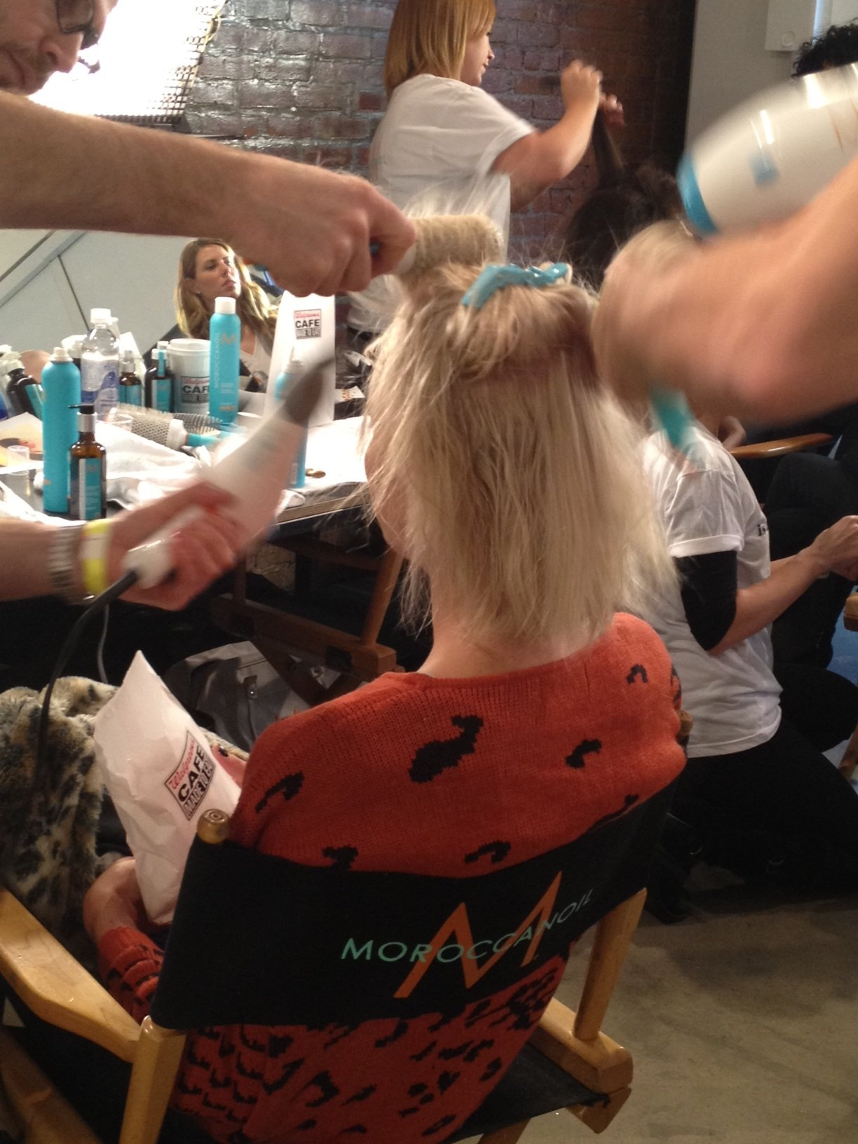 Stylists blow-drying to create volume.