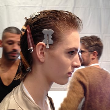 Hair set in clips backstage.