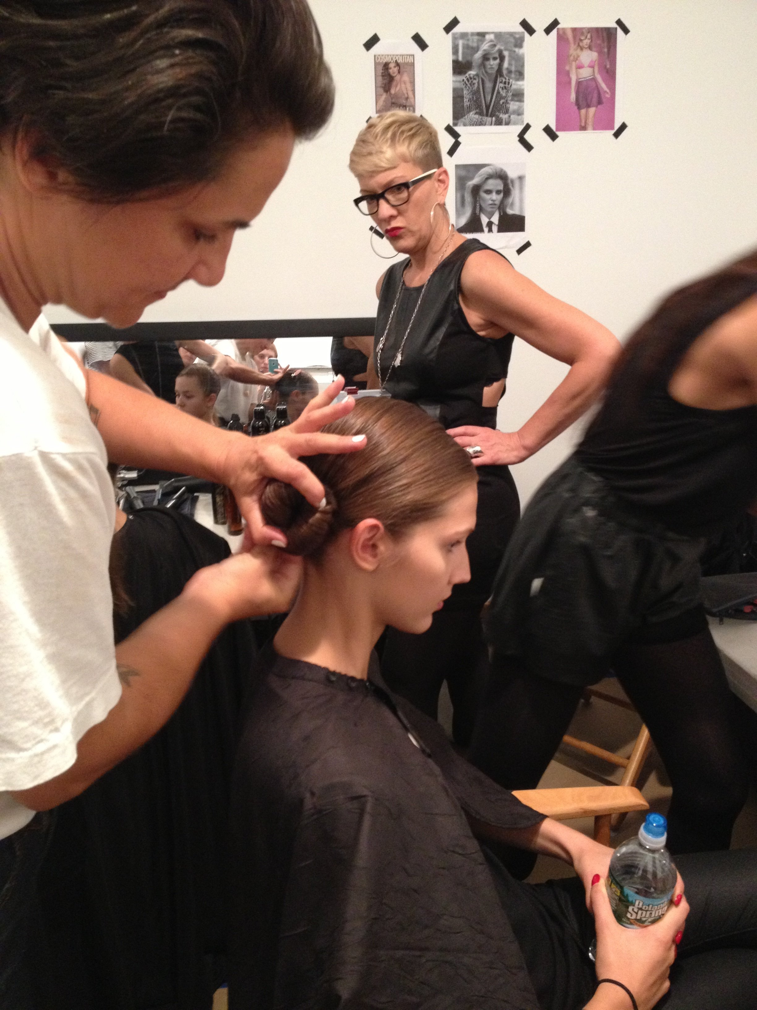 Smith twists hair to create chignon.