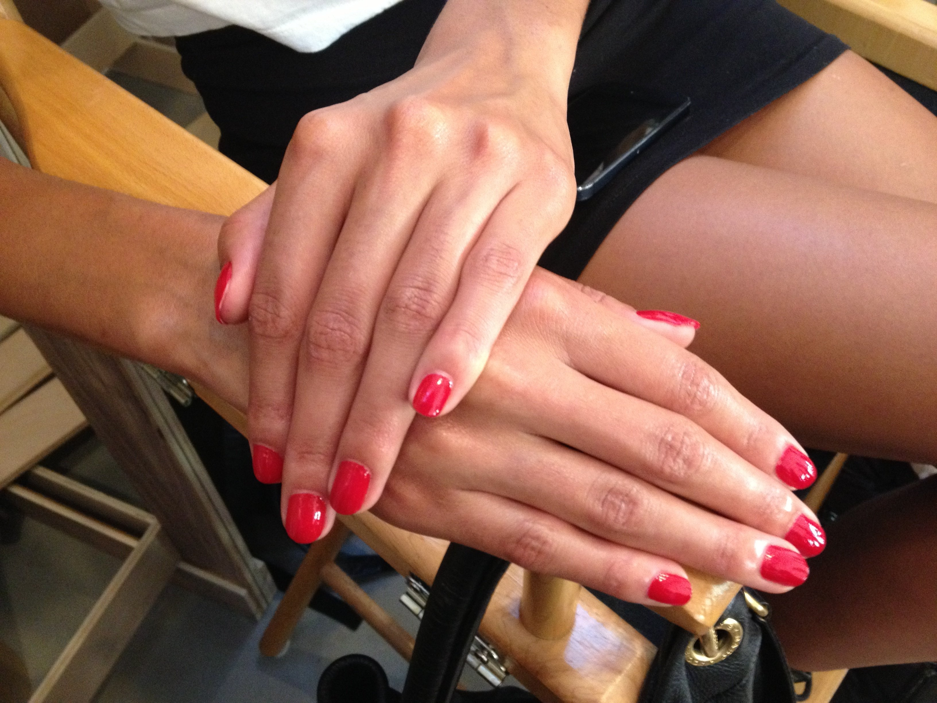 Red nails complete the look.