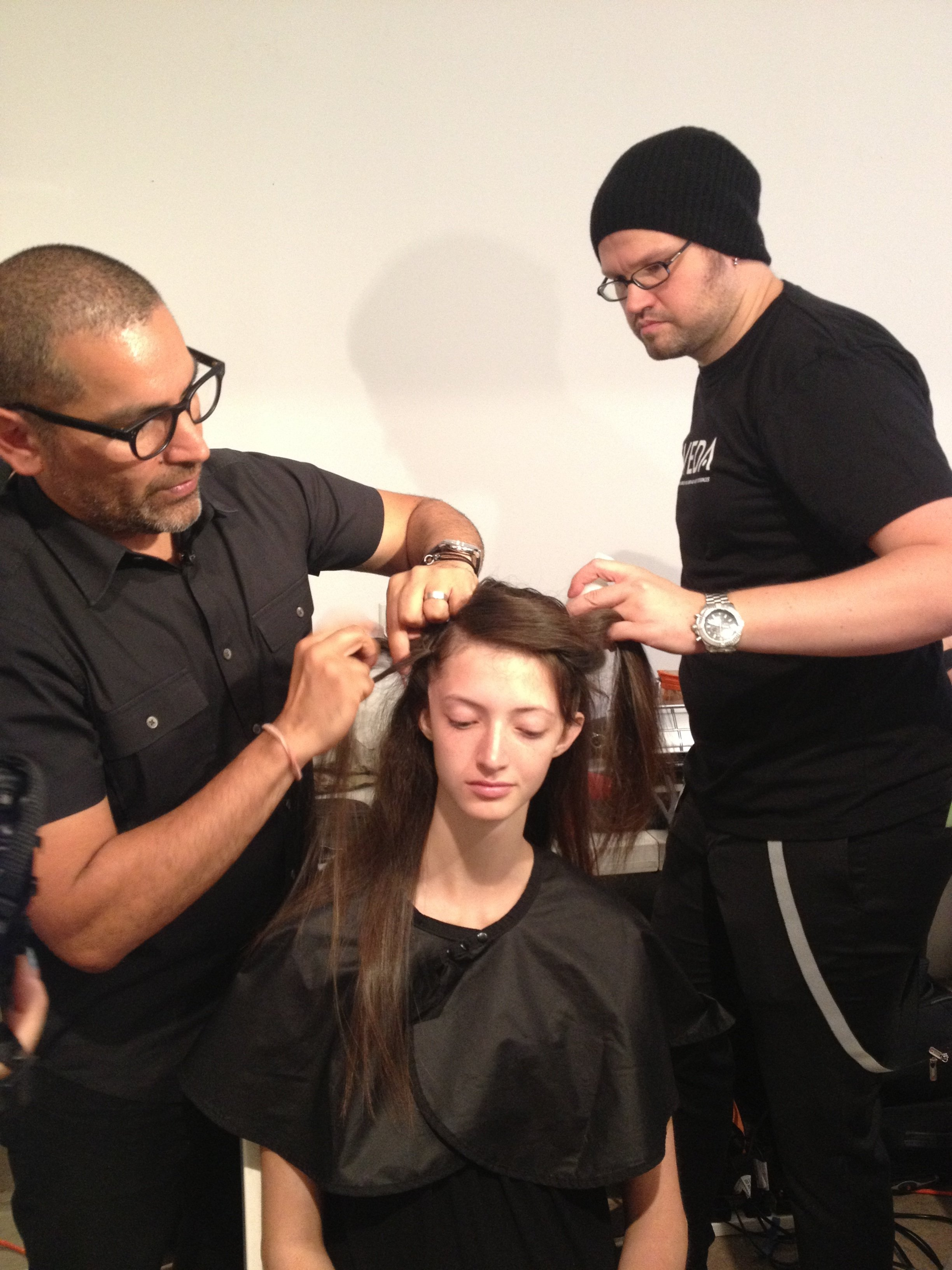 Allen Ruiz creates braids on either side of the head.