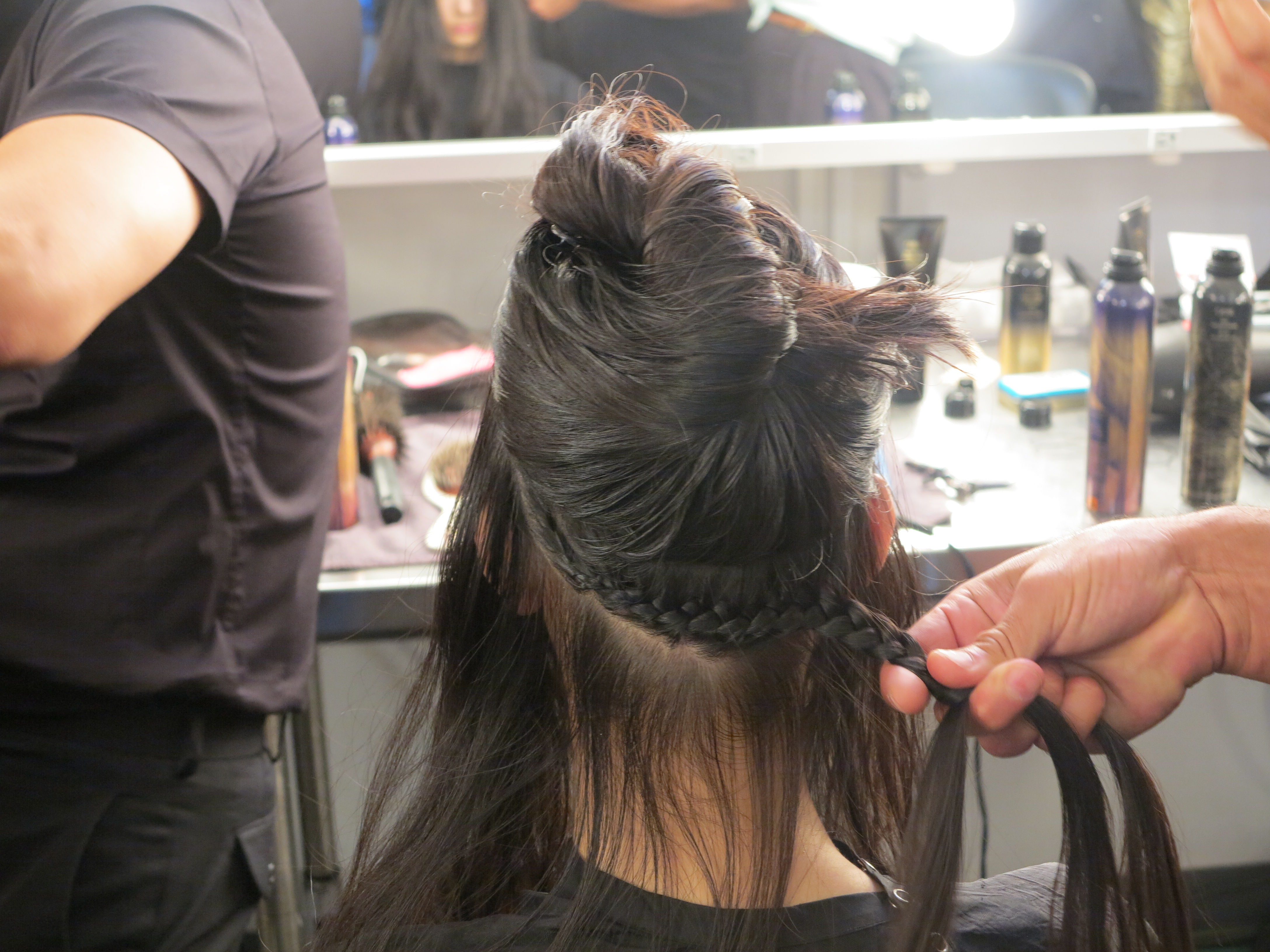 French braid created to sew hair to the head.