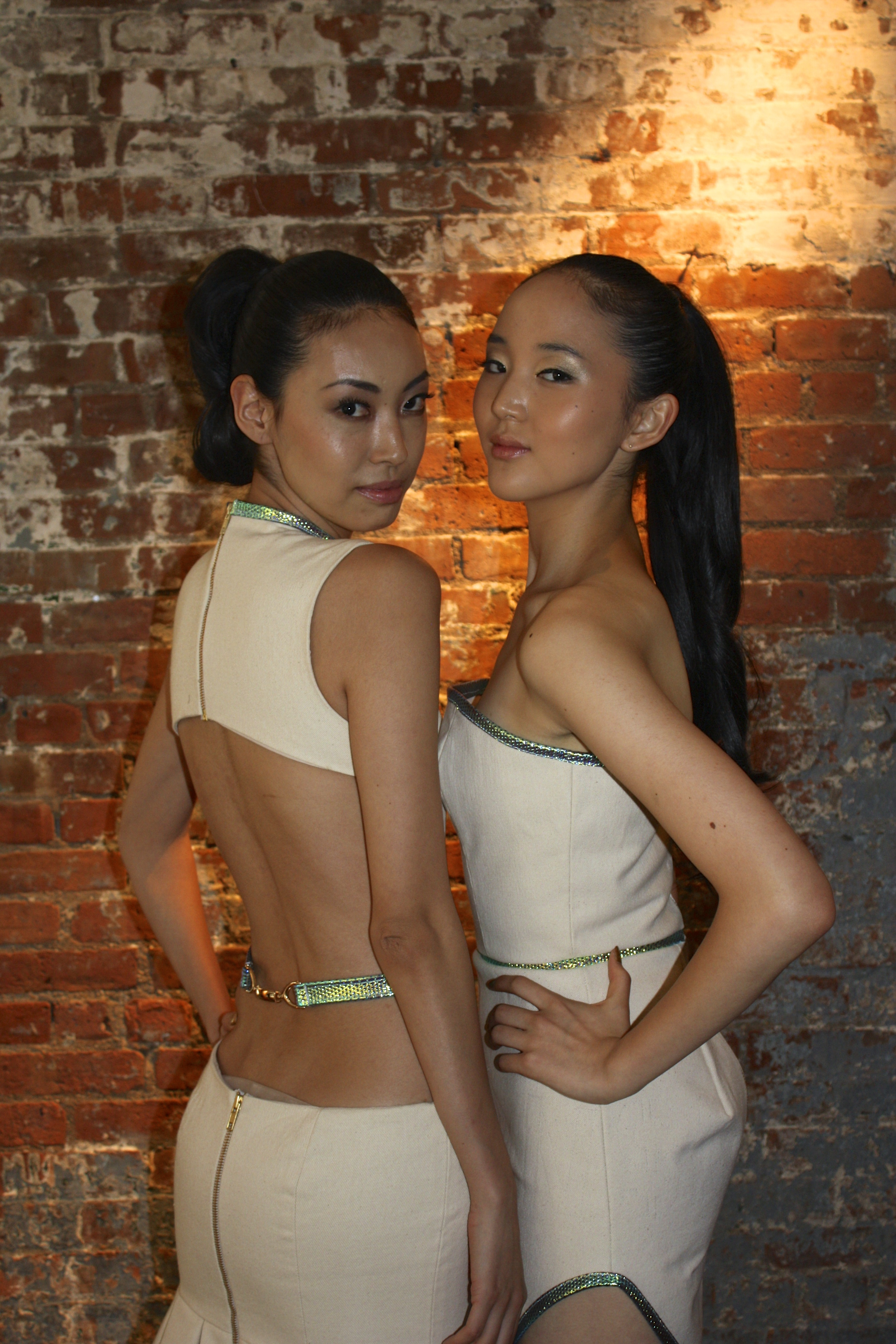 Two models pose before hitting the catwalk.
