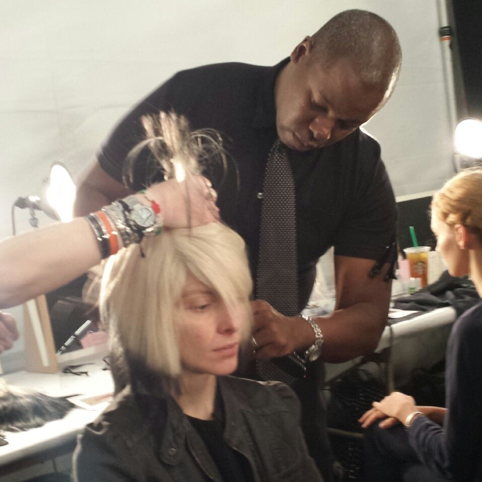 Ted Gibson styles the model's wig.